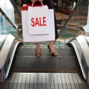 Woman with Shopping Bags on Escalator --- Image by © Royalty-Free/Corbis
